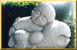 Bouddha enfant en sommeil - Photo © Christian Bernapel